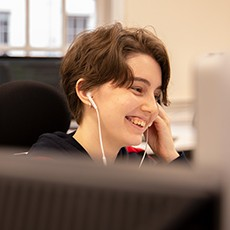 Developer smiling at work