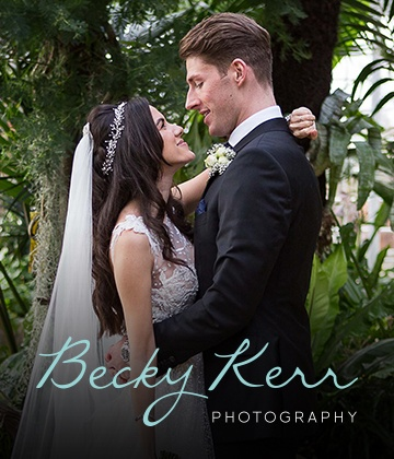 Photograph of a bride and groom on their wedding day with the Becky Kerr Logo